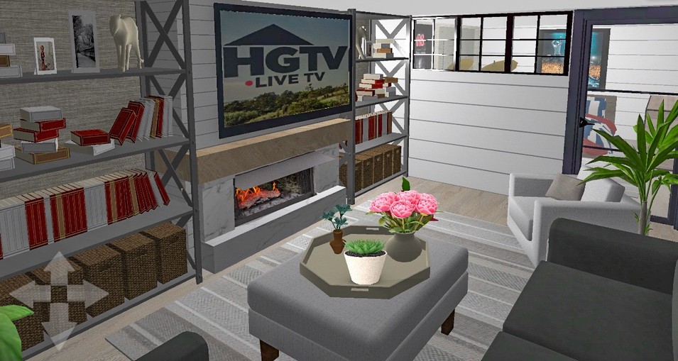 Cozy TV room with electric fireplace.