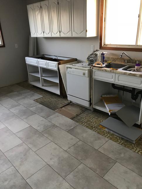 New floating tile floors going down.