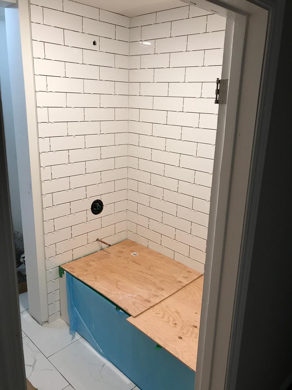 White subway shower tile.