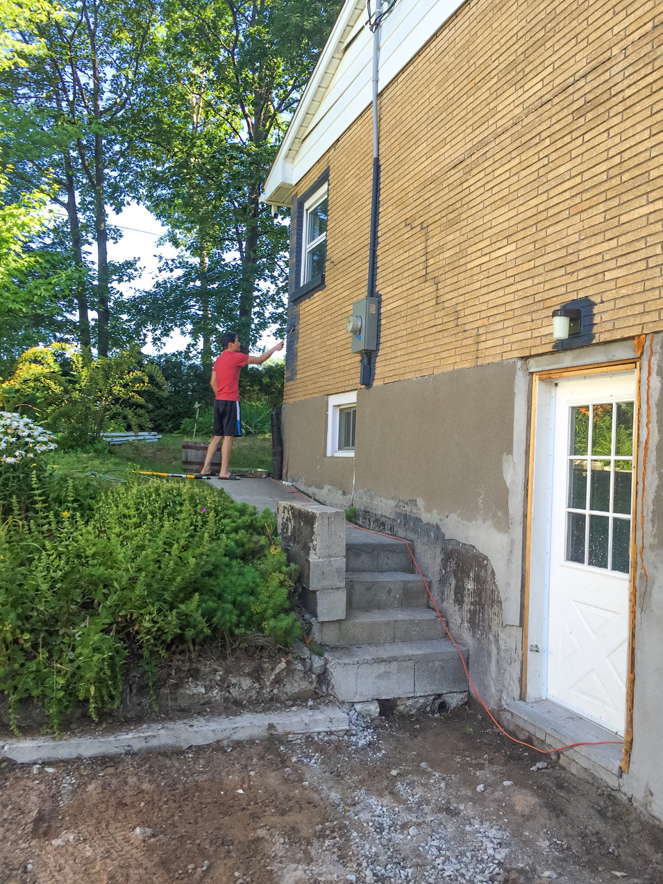 Starting to paint! we tried using masonry rollers but quickly switched to spraying the paint instead.