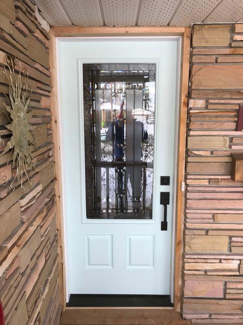 Door installed & trimmed with cedar.