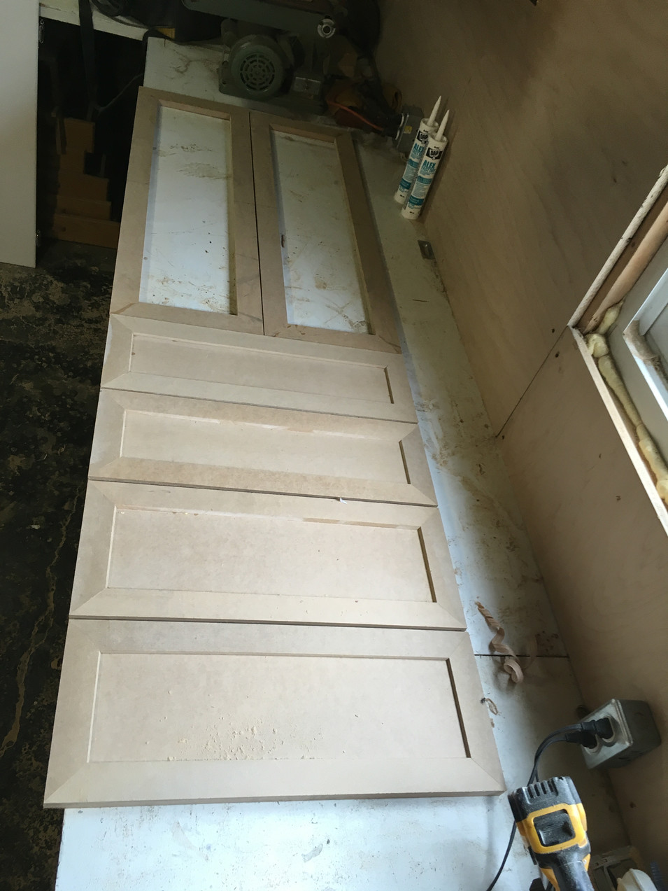 Custom made doors and drawers for the built-ins.