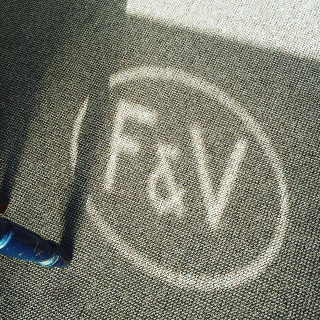 F&V Logo beaming on the carpet