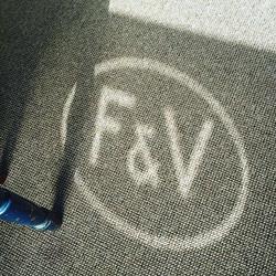 F&V Logo beaming on the carpet
