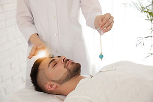 Young man during crystal healing session