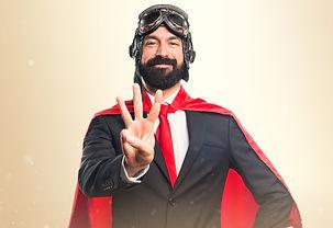 Super hero businessman counting three.jp