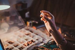 Talented jewellery beads maker is holdin
