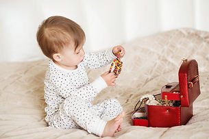Little girl admires the accessories in t
