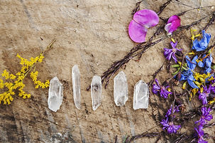 Five quartz crystal points styled with c