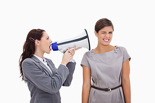 Businesswoman with megaphone yelling at