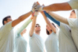 Group of people putting hands together