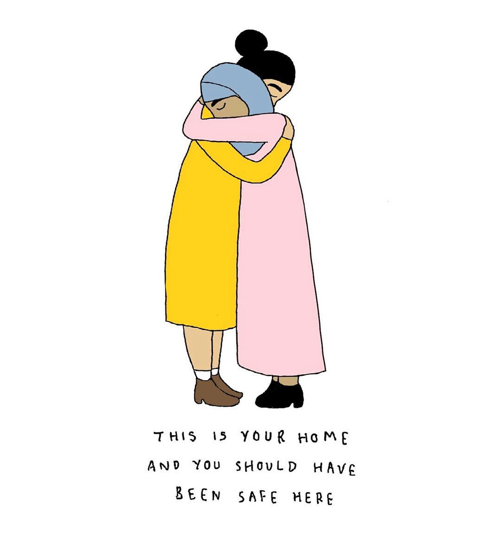Woman in headscarf hugging woman in yellow dress - this is your home and you should have been safe here -  Christchurch terror attack 2019
