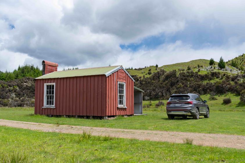 Hyundai Santa Fe next to red shed