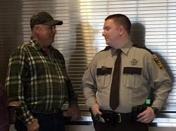 Life Saving Award. Gene Praus with Deputy Olson