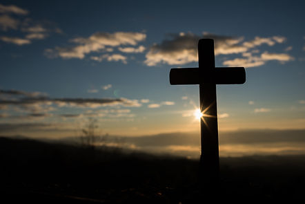 silhouette-of-catholic-cross-and-sunrise