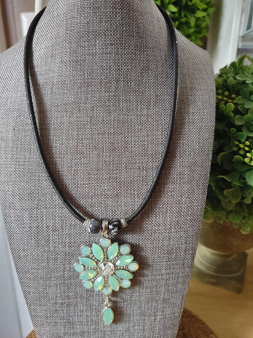 Mint green stone flower on thin black cork adjustable