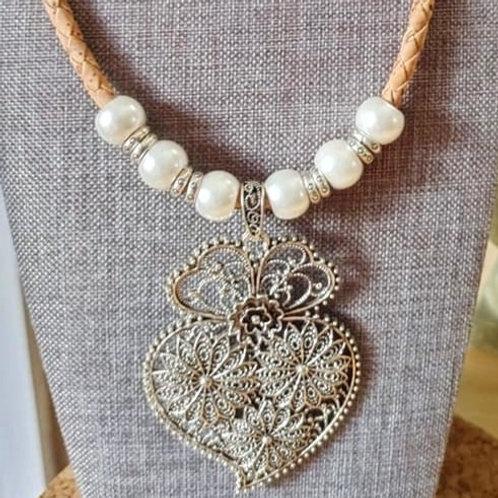 Viena Heart necklace on brown cork