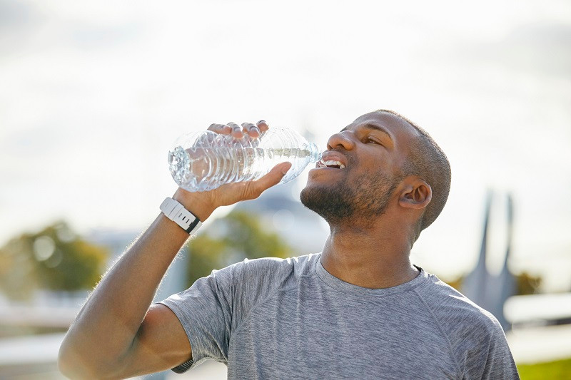 guy drinking water