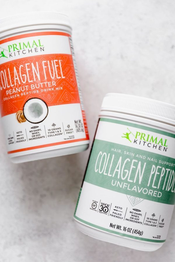 Primal Kitchen Peanut Butter Collagen Fuel and Unflavored Collagen Peptides containers on a white surface.