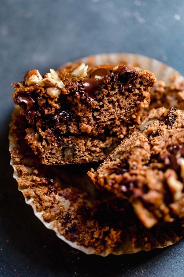 Close up of a Grain-Free Sweet Potato Banana Nut Muffin that has been sliced in half revealing the delicate crumb.