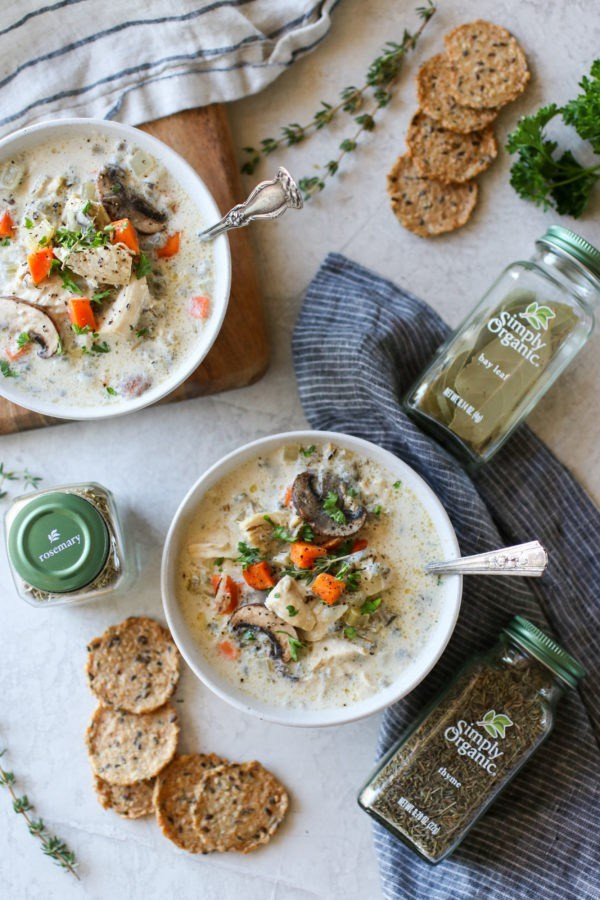 Overhead photo of two white bowls of Slow Cooker Creamy Chicken Wild Rice Soup.