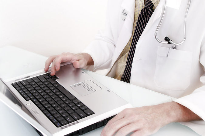 Kirsten Turkington Medical Doctor with Computer