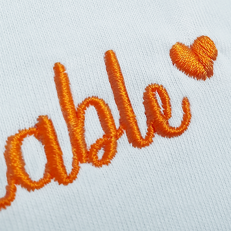 Unbreakable Recycled Tee with Orange Embroidery