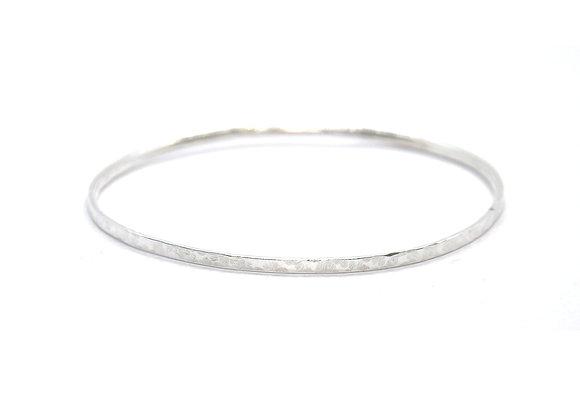 Thin silver hammered bangle