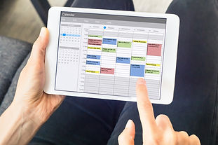 Calendar app on tablet computer with pla