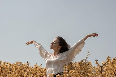 pexels-lady arms up wind -maksim-gonchar