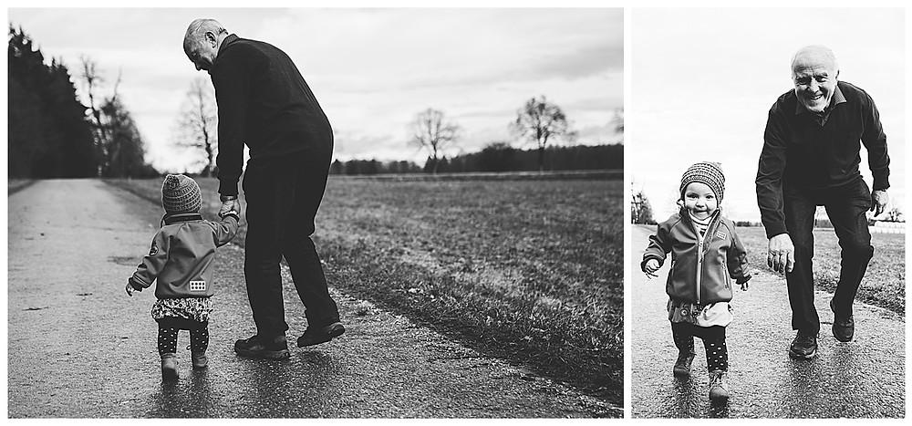 Opa und Enkeltochter gehen spazieren am Waldesrand