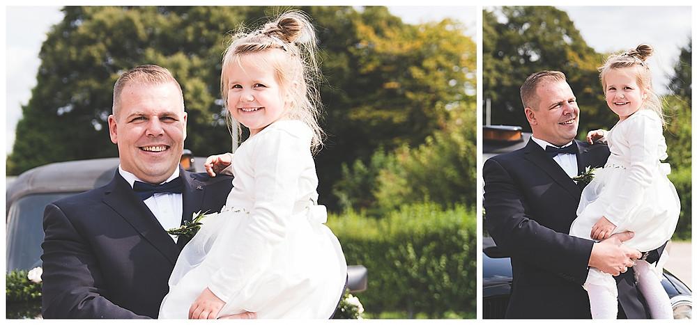 Bräutigam hält Tochter auf dem Arm