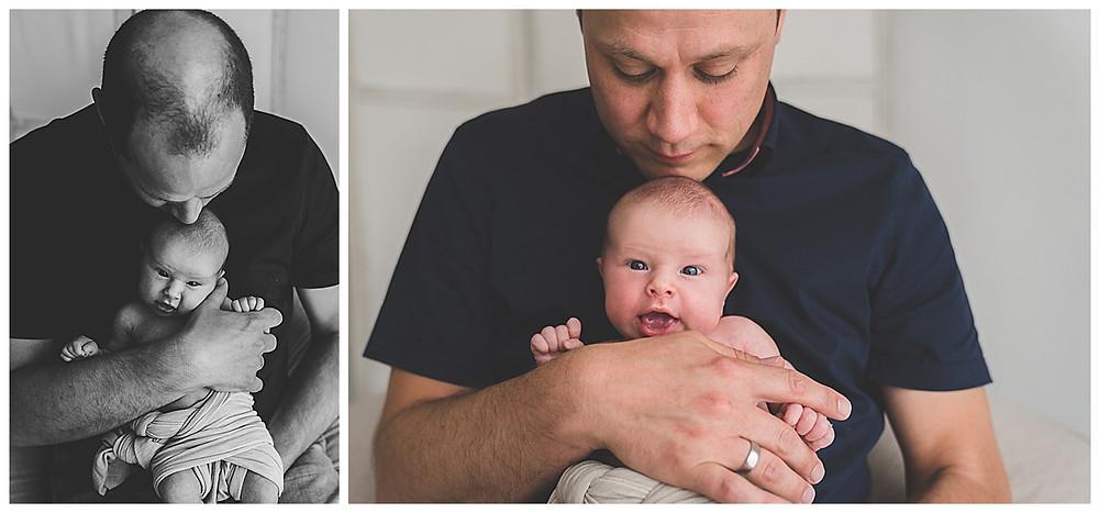 papa und baby bei babyshooting im Fotostudio
