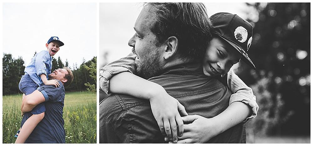 Sohn umarmt Papa und lacht