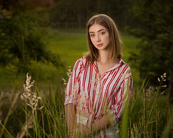 Model standing in field of grass in Bli Bli for model portfolio