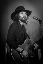 Black and White musician artist headshot taken at Caloundra Music Festival