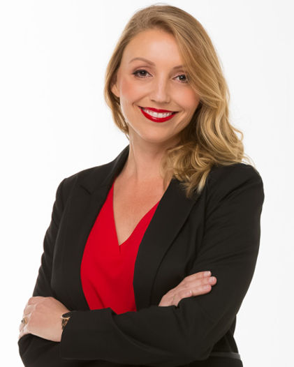 Corporate headshot of real estate agent.