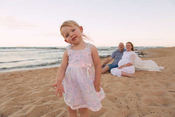 Young girl looking at the camera at Shelley Beach, Caloundra