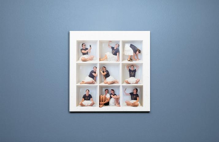 Nine box print hanging on wall.