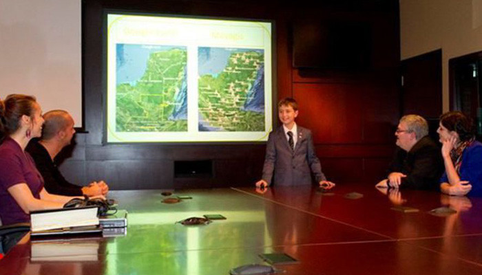 William Gadoury, 15, explains his theory of the existence of an unknown Maya city before scientists at the Canadian Space Agency. (Image: Canadian Space Agency)