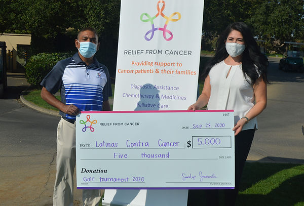 Donation check to Latinas Contra Cancer