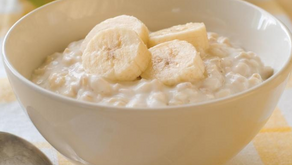 Almond Milk Porridge with Banana and Milled Sunflower and Goji Berries