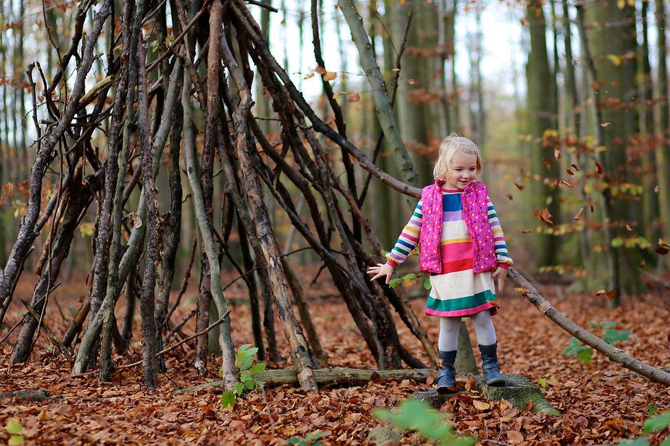 Happy little girl enjoying autumn outdoo