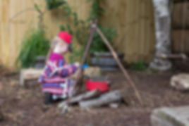girl playing in the forest school at Orchidale children's nursery