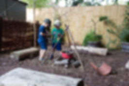 children playing in Orchidale Nursery Forest School