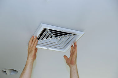 close-up-man-hand-installing-vent-cover-