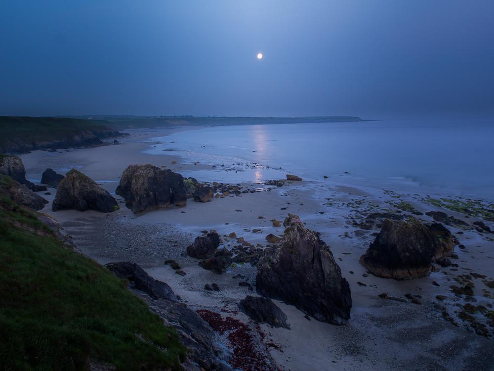 Moon setting over Penllech Beach