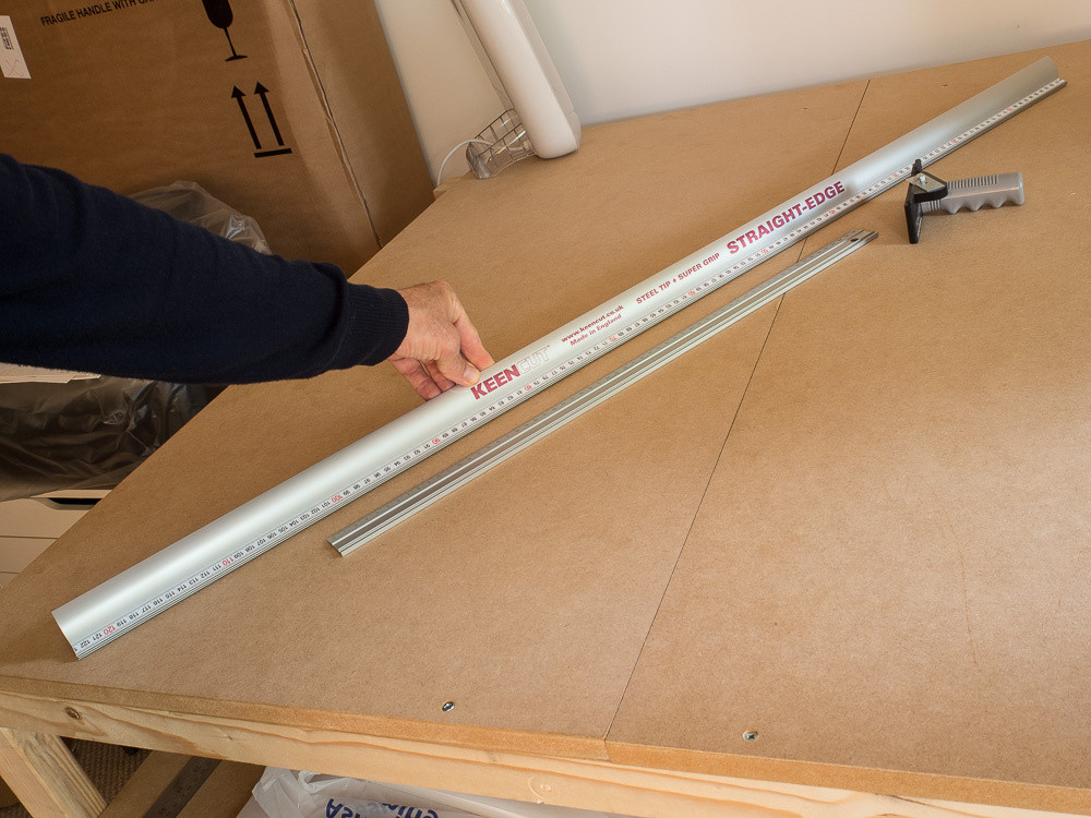 1.2m Kencut Safety Edge next to 60cm ruler for comparison, with logan cutting head that fits both