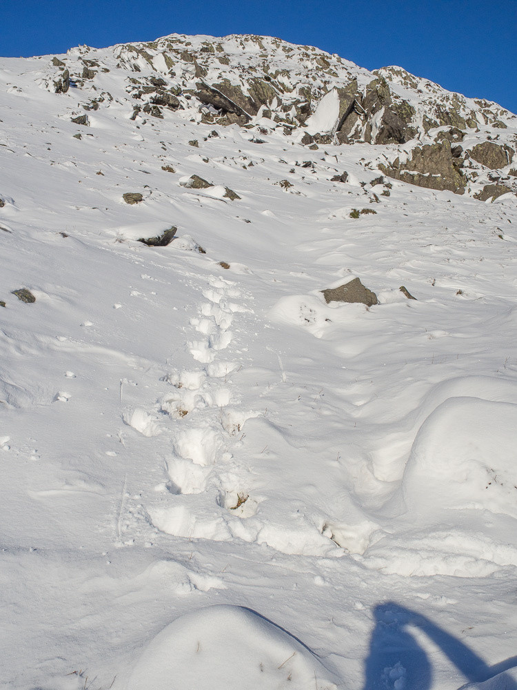 Post-holing up steep snow