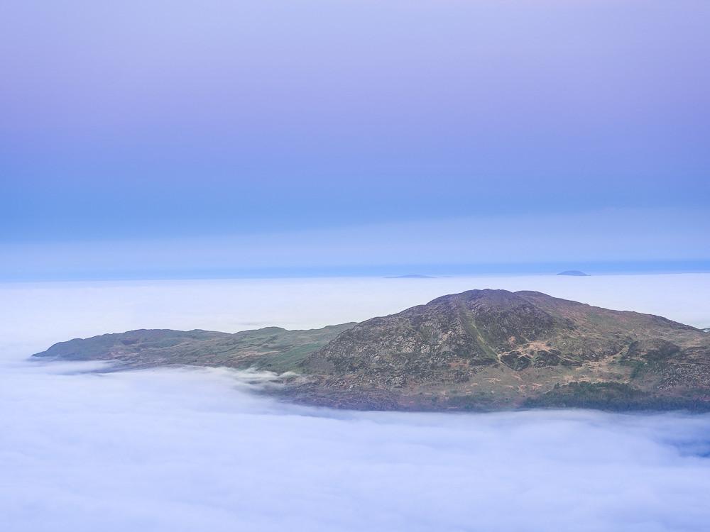 Moel-ddu above Porthmadog in a sea of cloud at dawn